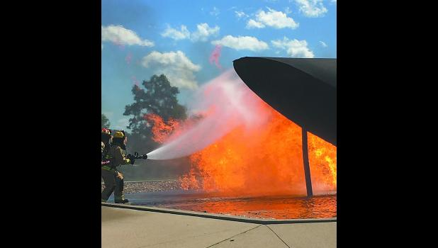 Firefighters from Joe Foss Field and South Dakota Air National Guard Crash Fire Rescue perform air rescue pit fire training. Joe Foss Field Station Captain Lonnie Albers celebrated his final pit fire training after 39 years of fire service as an Air Force, National Guard, career, and volunteer firefighter.