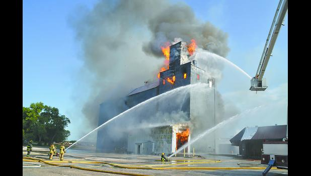 A 1948 structure at NEW Cooperative in Bode was burned in a training exercise on Saturday morning. A total of 60 firefighters from 14 fire departments took part in the exercise. See more photos inside this issue and at www.humboldtnews.com.