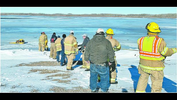 The Imperial Volunteer Fire Department was called out to rescue a golden retriever named Copper that had fallen through the ice about 250 to 300 feet offshore at Enders Lake.