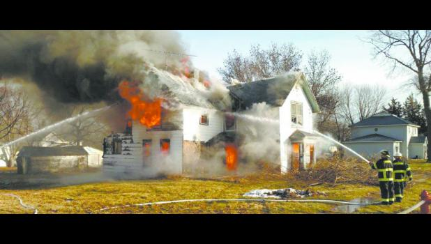 House burn in Livermore, Iowa. Photo by Kirk Hundertmark
