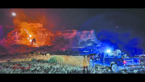 A Nebraska Game and Parks Commission fire rig guards the perimeter as the wildfire burns in the Wildcat Hills near McGrew on Aug. 28. Photo by Justin Powell.